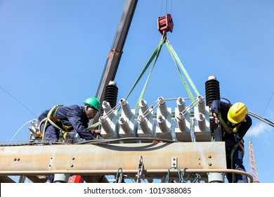 Johannesburg, South Africa, 04/11/2012, Electricians working on high voltage power lines. Highly skilled workmen servicing the electricity grid