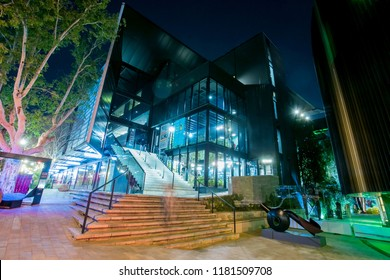 Johannesburg, South Africa - 11 September - 2018: Modern glass fronted building. Exterior of art gallery and decor venue at night.