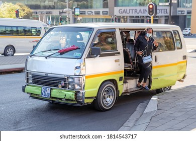 Johannesburg, South Africa, 11th September - 2020: Passenger getting out of mini bus taxi in city centre.