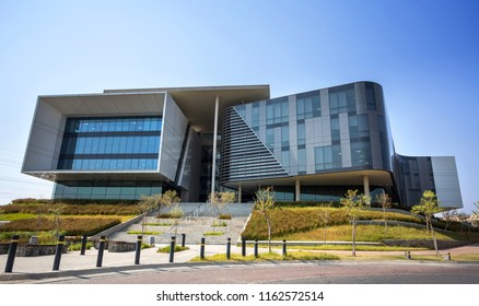 Johannesburg, South Africa, 22 August - 2018: Modern office building with concrete and glass exterior.