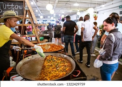 Johannesburg, South Africa, 24th February - 2019: Women looking at food on display at inner city food market