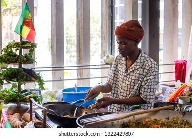 Johannesburg, South Africa, 24th February - 2019: Man preparing Ethiopian food at food market