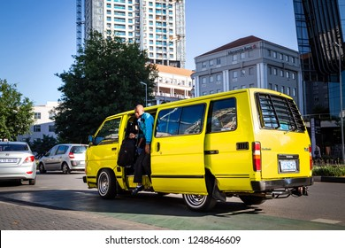 Johannesburg, South Africa, 28 November - 2018: Passenger getting out of mini bus taxi.