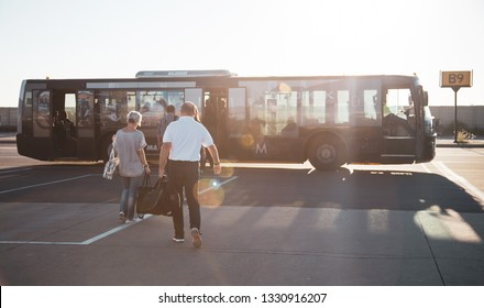 Johannesburg, South Africa, 28th February - 2019: Passengers boarding airport transfer bus