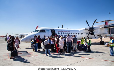 Johannesburg, South Africa, 28th February - 2019: Passengers waiting to board a plane on the tarmac.