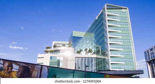 Johannesburg, South Africa, 4 December - 2018: Modern office buildings with glass exteriors reflecting sunlight.