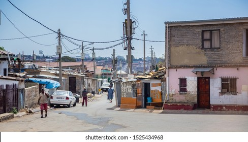 Johannesburg, South Africa , 4 October - 2019: Township street with tin shacks and small houses
