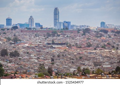 Johannesburg, South Africa , 4 October - 2019: View over township towards city centre with tin shack dwellings in foreground.