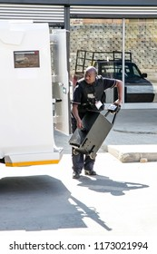 Johannesburg, South Africa  - 4 September, 2018: Security guard loading cash into cash in transit van.