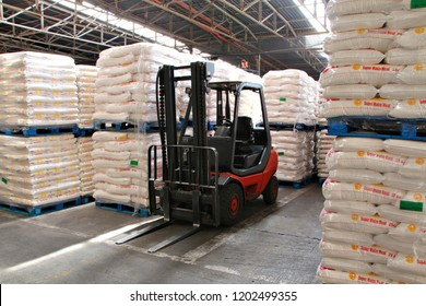 JOHANNESBURG, SOUTH AFRICA - 5 MARCH 2018: A forklift in an industrial flour mill in Johannesburg. Flour is a powder made by grinding raw grains or roots & used to make many different foods. Editorial