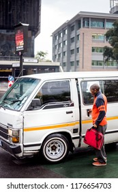Johannesburg, South Africa,  7 September - 2018: Mini bus taxi with passenger climbing out.