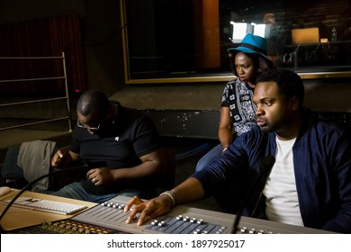 Johannesburg, South Africa - April 28, 2015: Nigerian Music producer Cobhams Asuquo working in studio with African artists