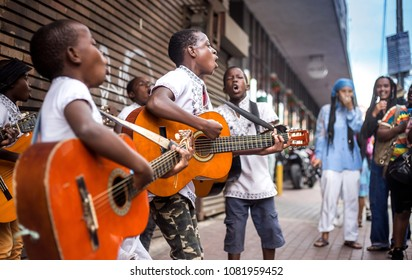 Johannesburg, South Africa, April 29-2018: Buskers playing on the streets. Kids playing guitars and singing in the city.