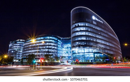 Johannesburg, South Africa, April 6 - 2018: Modern office building at night with traffic in the foreground.