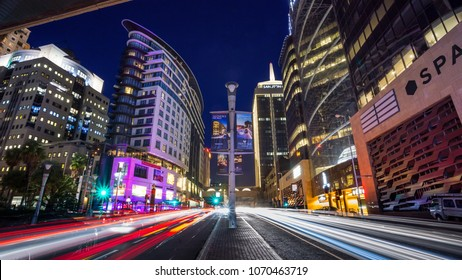 Johannesburg, South Africa, April 6 - 2018: Cityscape with modern office buildings at night and traffic in the foreground.
