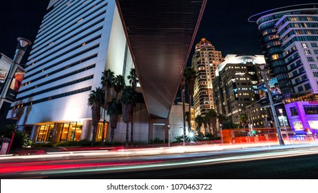 Johannesburg, South Africa, April 6 - 2018: Cityscape with modern office buildings at night and traffic in the foreground. Bridge overhead.