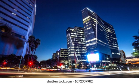 Johannesburg, South Africa, April 6 - 2018: Office buildings at night with traffic in the foreground.