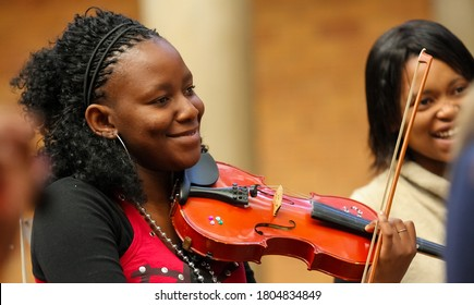 Johannesburg, South Africa - August 28 2010: Diverse youth at music school orchestra