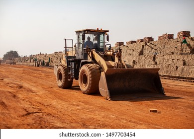 Johannesburg, South Africa - Circa July 2019 - Large 5 ton capacity Wheel Loader construction machine working in a brickyard application