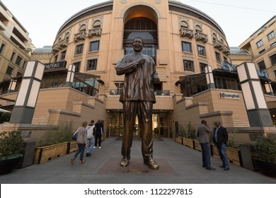 Johannesburg, South Africa, Circa, June 2018. A photograph of the Mandela Statue  with tourists walking past.