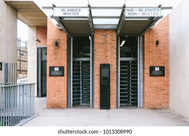 JOHANNESBURG, SOUTH AFRICA - CIRCA NOVEMBER 2017: Entrance to the Apartheid Museum in Johannesburg, simulating the separated entrances based on races during the apartheid in South Africa