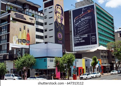 JOHANNESBURG, SOUTH AFRICA - CIRCA NOVEMBER 2016: City street lined with student housing and businesses in Braamfontein