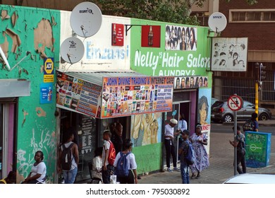 JOHANNESBURG, SOUTH AFRICA - CIRCA SEPTEMBER 2017: Row of small businesses with satellite dishes in the Braamfontein neighborhood