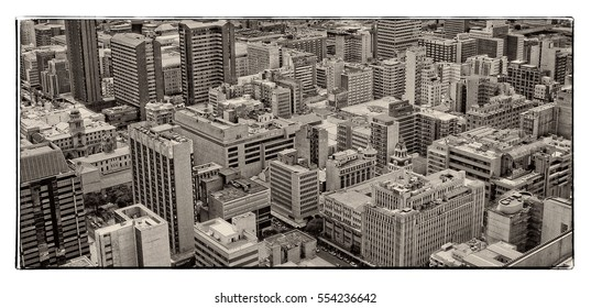 Johannesburg, South Africa - December 21, 2013: Johannesburg Central Business District has the most dense collection of skyscrapers in Africa. Johannesburg from aerial view. Old photo. Retro. Vintage