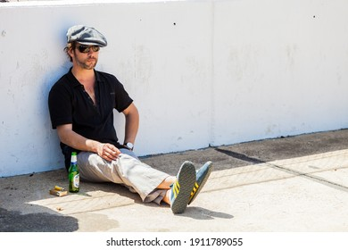 JOHANNESBURG, SOUTH AFRICA - Feb 20, 2019: Johannesburg, South Africa - October 05 2013: Jay Kay of Jamiroquai relaxing with a Cigarette next to a race track