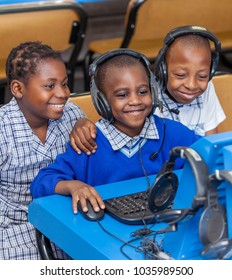 Johannesburg, South Africa, February 14, 2018: Kids looking at computer screen and learning about internet.