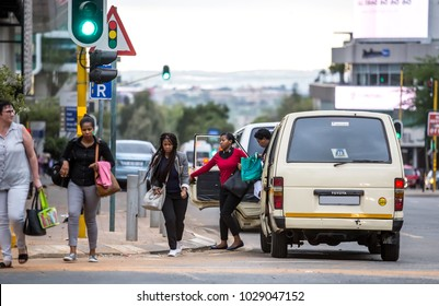 Johannesburg, South Africa -February 15, 2018: People getting out of a taxi in the city center