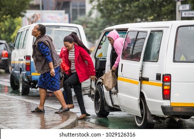 Johannesburg, South Africa -February 15, 2018: People getting out of taxi in city traffic