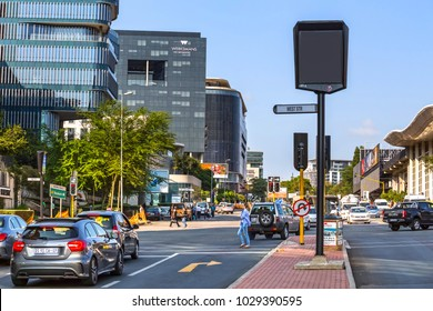 Johannesburg, South Africa -February 15, 2018:Traffic intersection with cars and modern buildings in background
