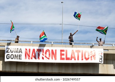 Johannesburg, South Africa -February 16, 2018. People waving flags and rejoicing above banner on motorway bridge.
