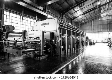 JOHANNESBURG, SOUTH AFRICA - Jan 06, 2021: Johannesburg, South Africa - October 16, 2012: Wide angle view of a large machine in a conveyor belt factory
