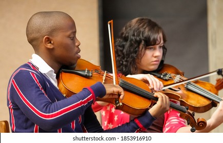 JOHANNESBURG, SOUTH AFRICA - Jan 23, 2019: Johannesburg, South Africa - August 28 2010: Diverse youth at music school orchestra
