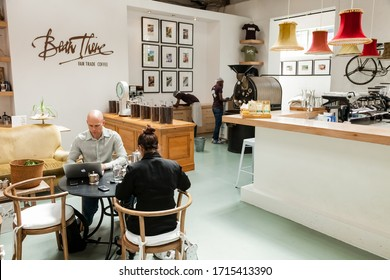 Johannesburg, South Africa - January 14, 2013: Customers sitting inside small independent fair trade coffee shop