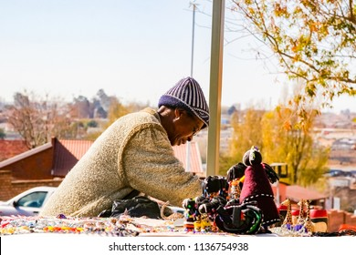 Johannesburg, South Africa, July 12, 2009, Old Lady selling African Curios on sale Outside Nelson Mandela's house in Vilakazi Street Soweto