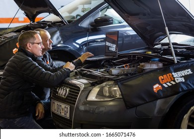 Johannesburg, South Africa - July 14, 2017: Mechanics in Car Service City Workshop repairing and diagnosing motor vehicles