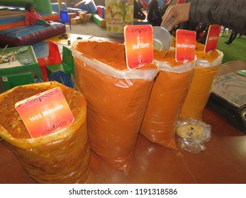 Johannesburg, South Africa – July 15, 2017: Big bags of hot, medium and mild curry and wet masala on display in Rosebank Sunday Market in Johannesburg