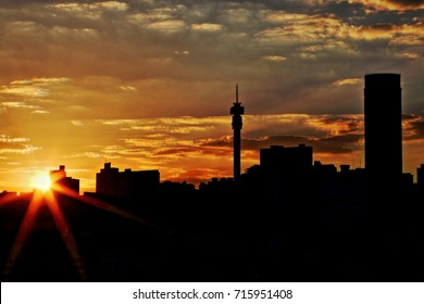 JOHANNESBURG, SOUTH AFRICA - June 17, 2017: Sunset view of the Johannesburg city skyline including the Ponte and Hillbrow Towers (silhouette effect).