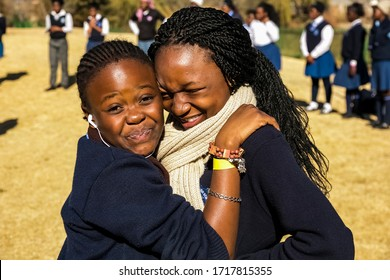 Johannesburg, South Africa - June 19, 2014: Diverse African high school pupils messing about on the sports field