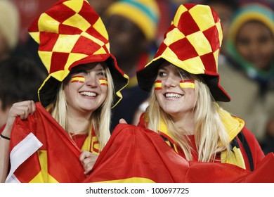 JOHANNESBURG, SOUTH AFRICA - JUNE 21:  Spain supporters smile in the stands at a FIFA World Cup match June 21, 2010 in Johannesburg, South Africa.