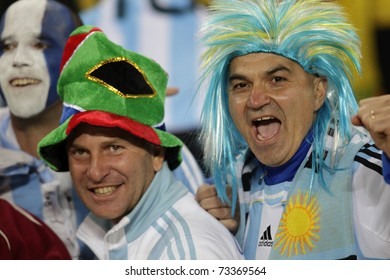 JOHANNESBURG, SOUTH AFRICA - JUNE 27:  Argentina supporters cheer at a World Cup soccer match between Argentina and Mexico June 27, 2010 in Johannesburg, South Africa.