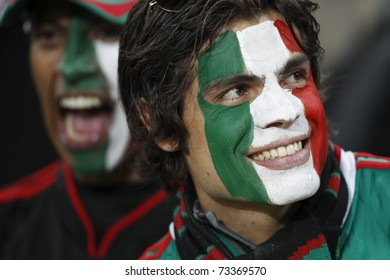 JOHANNESBURG, SOUTH AFRICA - JUNE 27:  Mexico supporters smiling and cheering at a World Cup soccer match between Argentina and Mexico June 27, 2010 in Johannesburg, South Africa.