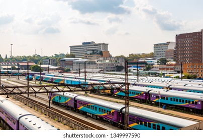 Johannesburg, South Africa - March 06, 2019: The Braamfontein Railway Yards with their colorful trains under the Nelson Mandela Bridge.