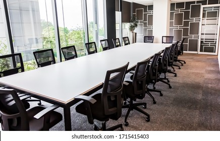 Johannesburg, South Africa - March 1, 2017: Empty modern boardroom table and chairs