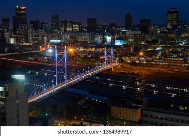 Johannesburg, South Africa - March 16 2019: Downtown Johannesburg and the Nelson Mandela bridge on an early autumn night with the lights on