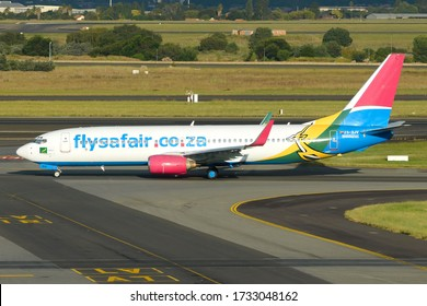 Johannesburg / South Africa - March 19 2019: FlySafair Boeing 737 ZS-SJV at O. R. Tambo Airport. B737 of low cost airline. Fly Safair operates domestic flights. Air travel in South Africa.