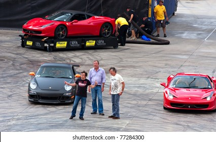 """JOHANNESBURG, SOUTH AFRICA- MARCH 20: Jeremy Clarkson, Richard Hammond and James May from the BBC TopGear show arrive at the Topgear Festival at Kyalami in the """"Thunderdome"""" show on March 20, 2011 in Johannesburg, South Africa."""